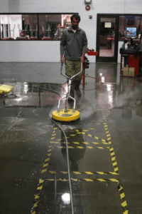 Man Washing Industrial Floor