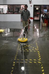Man Washing Industrial Floor